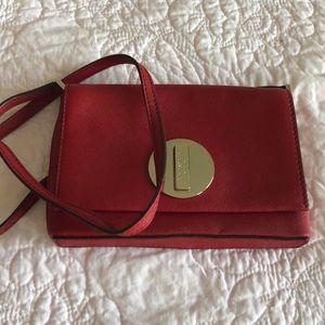 Red Kate Spade cross-body bag
